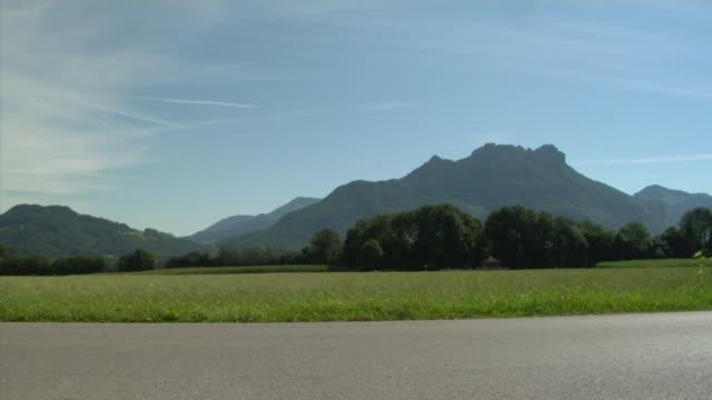 ws woman jogging in alpine landscape, bavaria, germany - full length点の映像素材/bロール