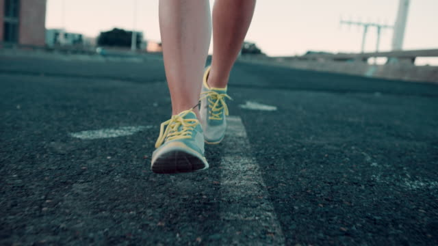 woman jogging in urban setting - jogging stock videos & royalty-free footage