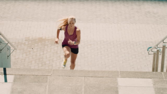 woman jogging on stairs - effort stock videos & royalty-free footage