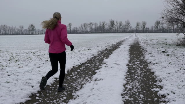 woman jogging on winter morning