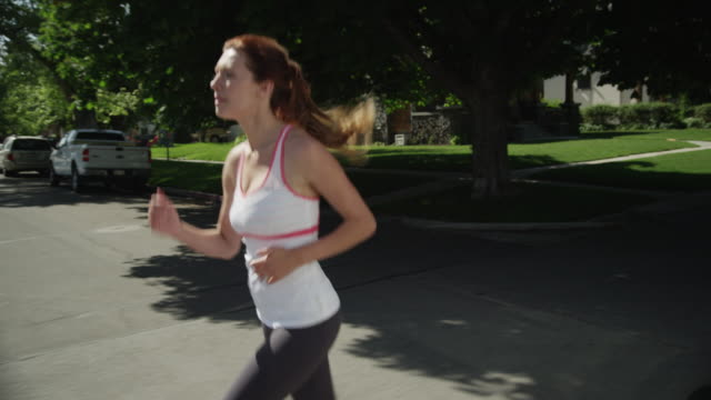slo mo ms ds ts woman jogging / provo, utah, usa - provo stock-videos und b-roll-filmmaterial
