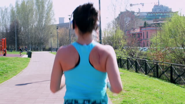 woman jogging - brown hair stock videos & royalty-free footage