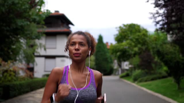woman jogging - one mid adult woman only stock videos & royalty-free footage
