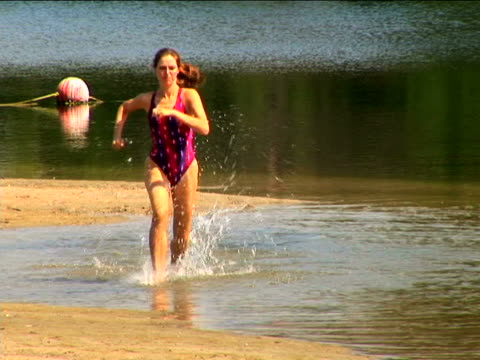 woman jogging - swimming costume stock videos and b-roll footage
