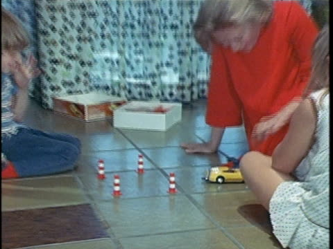 1971 CU ZO WS Woman joining children and other woman playing with toys on floor, Los Angeles, California, USA, AUDIO