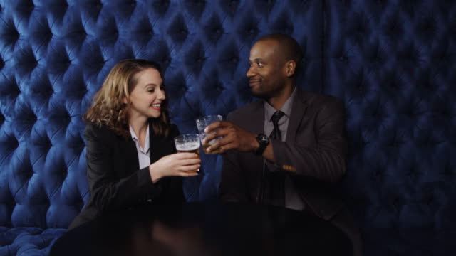 woman joining man for drinks - next to stock videos and b-roll footage