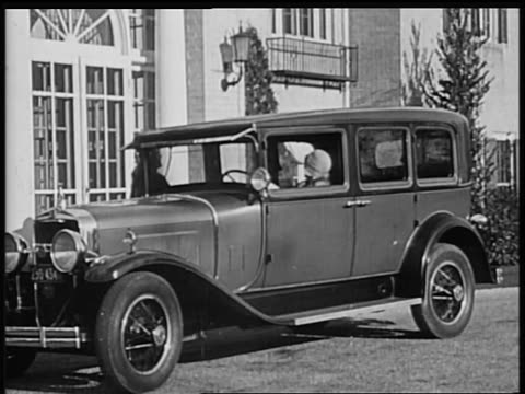 b/w 1928 woman joining other woman in la salle car / industrial - 1928 stock-videos und b-roll-filmmaterial