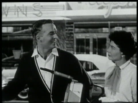 b/w 1959 woman joins man looking off screen - 1959 stock videos & royalty-free footage