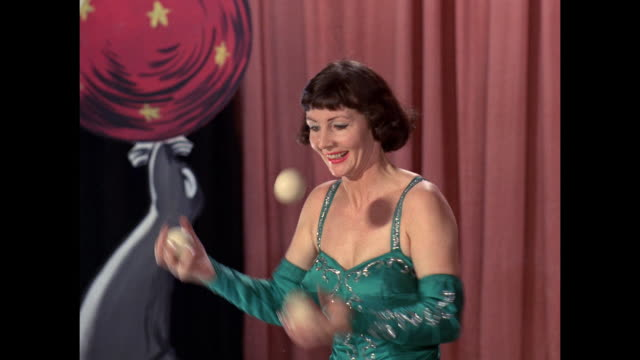 woman juggling 3 balls - group of objects stock videos & royalty-free footage