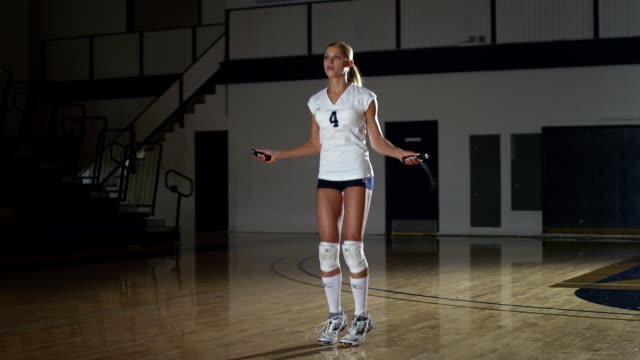 MS Woman jump ropes in gym / Riverside, California, United States