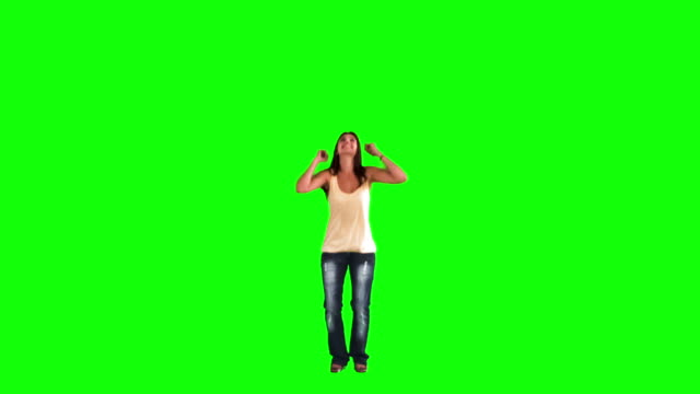 woman jumping in slow motion while doing a star jump - star jump stock videos & royalty-free footage
