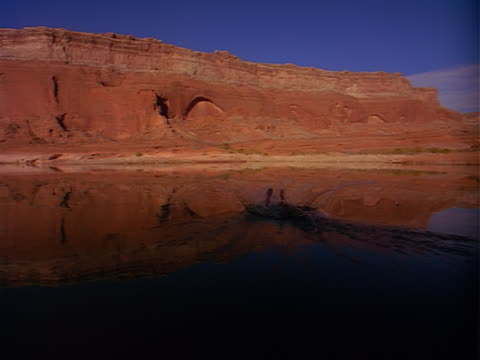 woman jumping into lake in beautiful red rock southwest setting - red lake stock videos & royalty-free footage