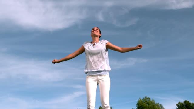 stockvideo's en b-roll-footage met woman jumping on a trampoline - trampoline