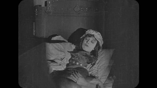 1916 woman (mabel normand) jumps excitedly into bed as husband (fatty arbuckle) walks slowly over to different bed - fatty arbuckle stock videos and b-roll footage