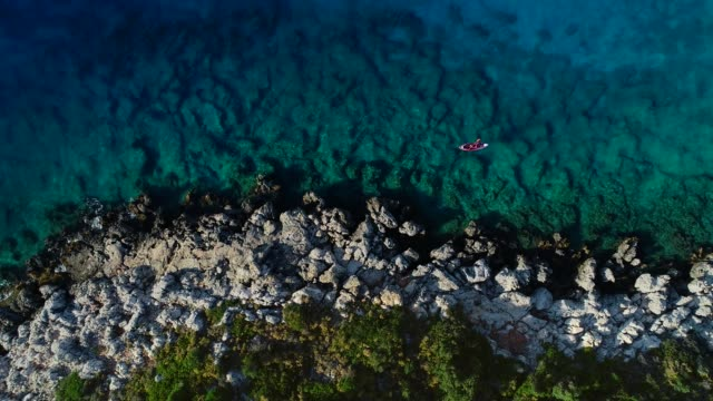 woman kayaking clear turquoise sea - using a paddle stock videos & royalty-free footage