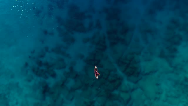 woman kayaking clear turquoise sea - idyllic stock videos & royalty-free footage