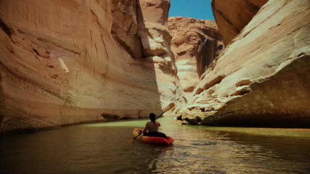 woman kayaking in canyons of powell lake recreational area - lake powell stock videos and b-roll footage