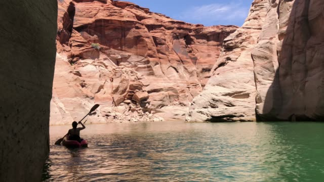 woman kayaking in canyons of powell lake recreational area - lake powell stock videos & royalty-free footage