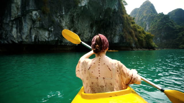 woman kayaking in halong bay - halong bay stock videos and b-roll footage