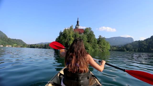 woman kayaking in the lake - lake bled stock videos & royalty-free footage