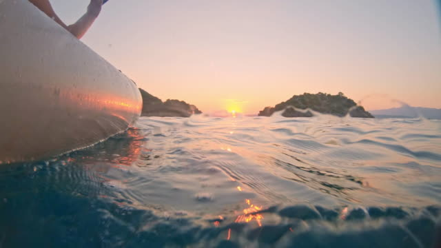 MS Woman kayaking on blue ocean at sunset,Peljesac,Croatia