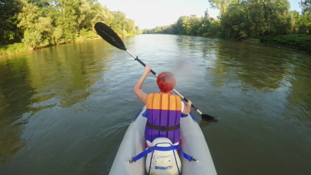 Woman kayaking on the river