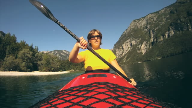 hd: woman kayaking. - using a paddle stock videos & royalty-free footage