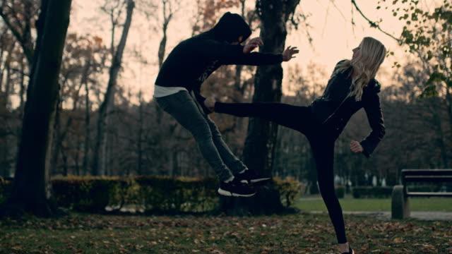 slo mo woman kicks a man in a self defense - insanity stock videos & royalty-free footage