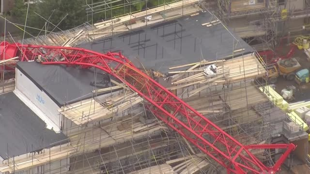 woman killed in crane collapse named as 85yearold june harvey england london bow base of collapsed crane uprooted from ground and crane neck fallen... - tilt up stock videos & royalty-free footage