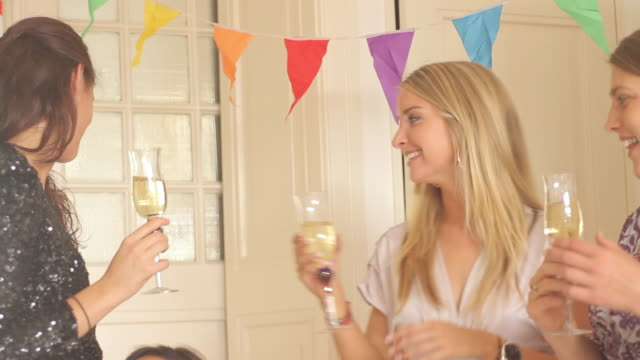 woman kissing and congratulating other female on birthday party - 30 34 years stock videos & royalty-free footage