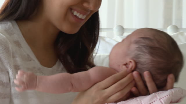CU Woman kissing newborn baby girl / Richmond, Virginia, USA
