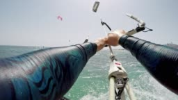 POV Woman kiteboarding in sunshine
