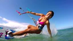 Woman Kitesurfing In Ocean, Extreme Summer Sport