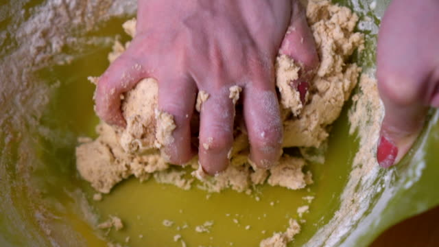 woman kneading dough for cookies - kneading stock videos and b-roll footage