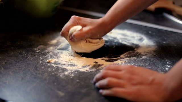 woman kneading dough in kitchen - italian culture stock videos & royalty-free footage