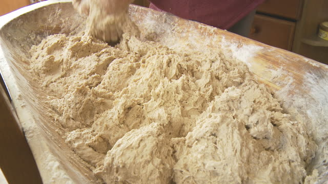 hd dolly: woman kneading yeast dough - peasant bread stock videos and b-roll footage