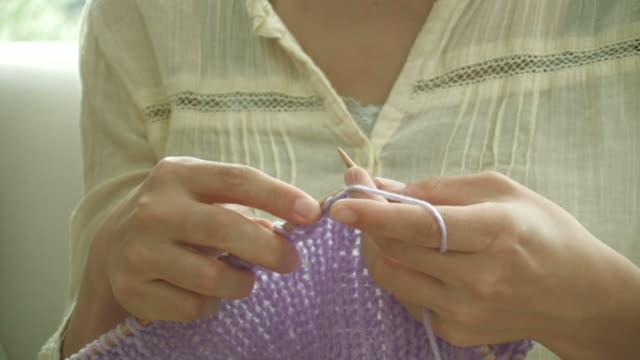 CU Woman knitting