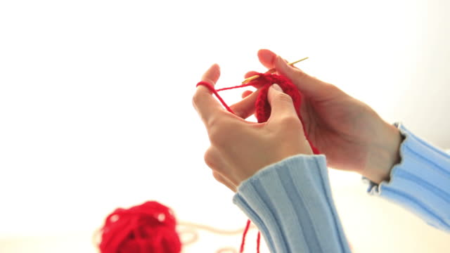MS Woman Knitting with red wool / Shibuya-ku, Tokyo, Japan