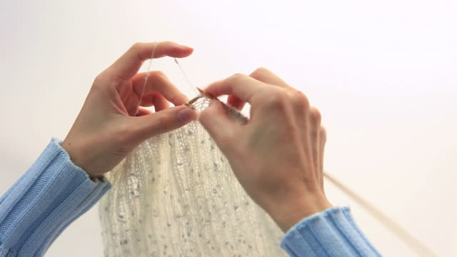 MS Woman Knitting with white wool / Shibuya-ku, Tokyo, Japan