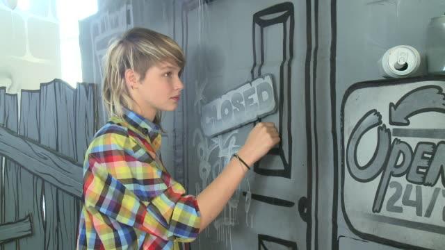 CU ZO woman knocking on painted door