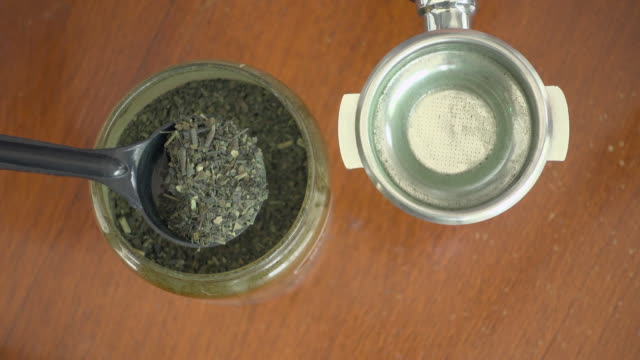 woman ladle dry green tea by spoon - ladle stock videos & royalty-free footage