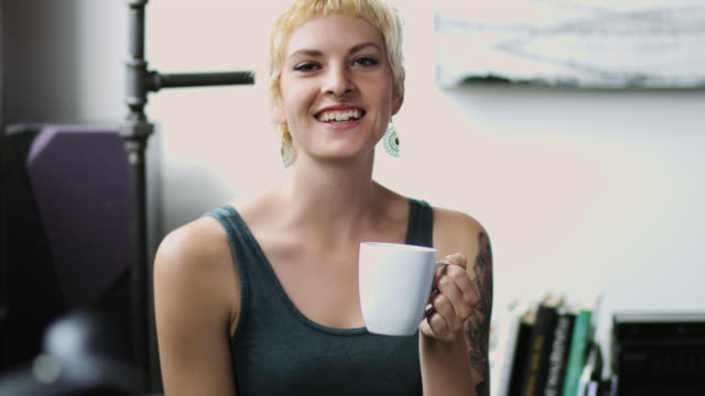 woman laughing and drinking coffee - nose ring stock videos & royalty-free footage