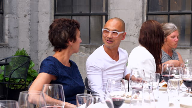 ms woman laughing with husband during celebration dinner with friends - zungenkuss stock-videos und b-roll-filmmaterial