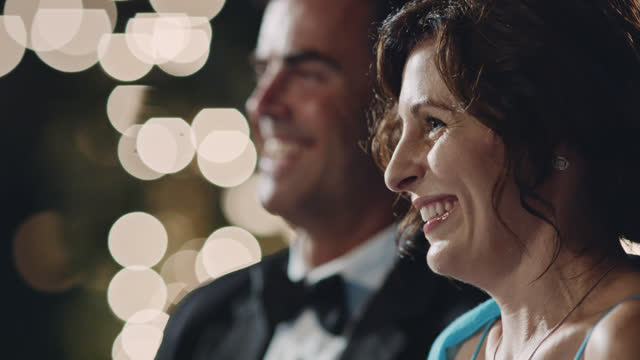 slo mo. woman laughs and smiles at joyful wedding reception ceremony. - life events stock videos & royalty-free footage