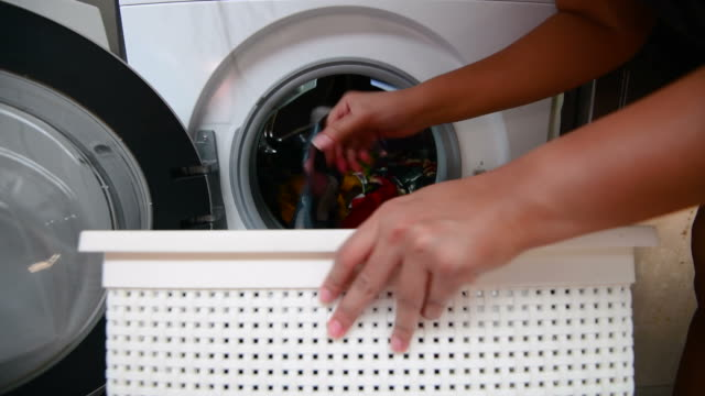 woman laundry at home - heap stock videos & royalty-free footage