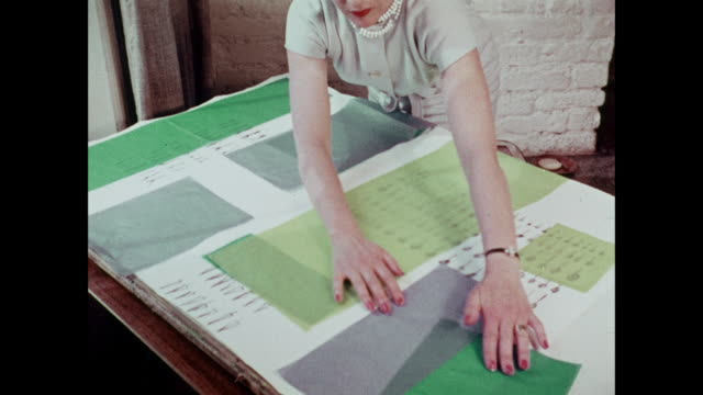 MONTAGE Woman laying fabrics on design board and designers drawing sketches / United Kingdom