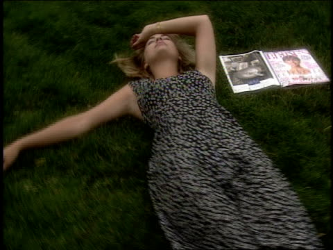 woman laying in grass next to wedding planner in pennsylvania - eyes closed stock videos & royalty-free footage