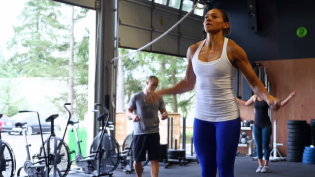ms woman leading jump rope workout with friends in gym gym - jump rope stock videos and b-roll footage
