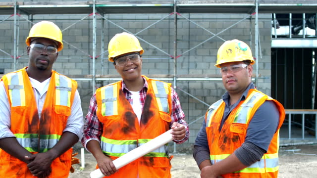 woman leading team of construction workers - construction worker stock videos & royalty-free footage
