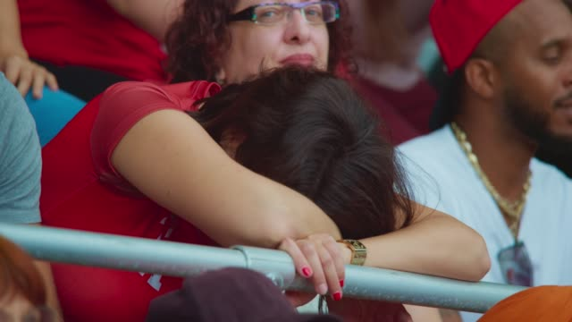 woman leaning her head on the stadium fence deeply disappointed with the game - disappointment stock videos & royalty-free footage